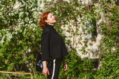 Portrait of forty-year-old red-haired woman in profile outdoors. In summer stock photos