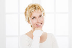 Portrait of forty years woman. Nice forty years old woman with short blonde hair Royalty Free Stock Photos