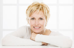 Portrait of forty years woman. Nice forty years old woman with short blonde hair Royalty Free Stock Photography