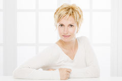 Portrait of forty years woman. Nice, forty years old woman with short blonde hair Stock Photos