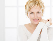 Portrait of forty years woman. Nice, forty years old woman with short blonde hair Royalty Free Stock Photo