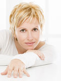 Portrait of forty years woman. Nice, forty years old woman with short blonde hair Stock Images