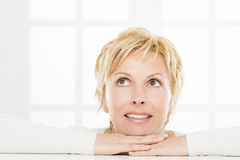 Portrait of forty years woman. Nice, forty years old woman with short blonde Royalty Free Stock Image
