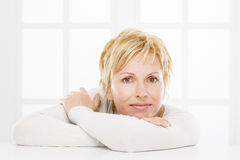 Portrait of forty years woman. Nice, forty years old woman with short blonde Stock Photography