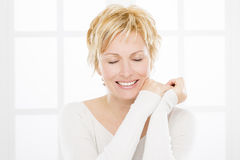 Portrait of forty years woman. Nice forty years old woman with short blonde hair making a wish Royalty Free Stock Photos