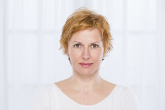 Portrait of forty years woman. Nice, forty years old woman with short red hair Royalty Free Stock Photography
