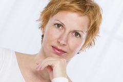 Portrait of forty years woman. Nice, forty years old woman with short red Stock Image