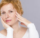 Portrait of forty years woman. Nice, forty years old woman with short red hair Royalty Free Stock Photos