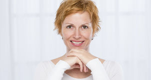 Portrait of forty years woman. Nice, forty years old woman with short red Royalty Free Stock Image
