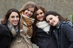 Portrait of four attractive young women Stock Images