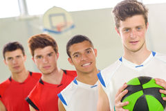 Portrait four basketball players Stock Photo
