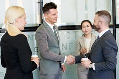 Group of Business People Shaking Hands royalty free stock images
