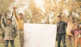 Portrait of four children in the park. Happy kids enjoying in a stock images