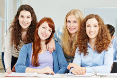 Four female teenager in school. Portrait of four female attractive teenager in a school class Stock Photos