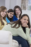 Portrait of a four teenage girlfriends having fun Stock Photography