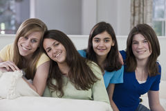 Portrait of a four teenage girlfriends having fun Royalty Free Stock Photography