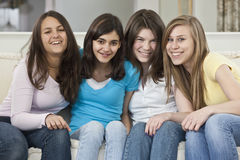 Portrait of a four teenage girlfriends having fun Royalty Free Stock Photo