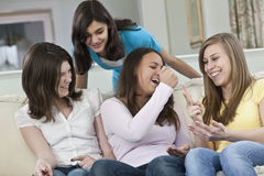 Portrait of a four teenage girlfriends having fun Royalty Free Stock Images