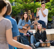 Portrait of four teenagers playing music together outdoors Royalty Free Stock Photography