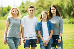Portrait of four teenagers standing and holding thumbs up togeth Royalty Free Stock Image