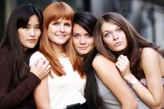 Portrait of four urban women Stock Images