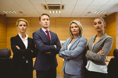 Portrait of four well-dressed lawyer with arms crossed Royalty Free Stock Image