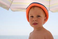 Portrait of four years boy on beach Royalty Free Stock Photos
