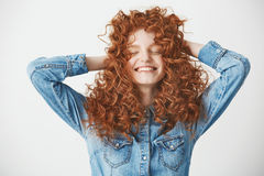 Portrait of foxy beautiful girl touching hair smiling with closed eyes over white baackground. Portrait of young foxy beautiful girl touching hair smiling with Royalty Free Stock Photos