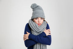 Portrait of a freezing woman in winter cloth Stock Images