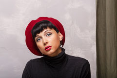 Portrait of Frenchwoman beret. Royalty Free Stock Images