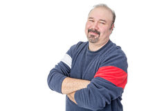 Portrait of a friendly balding mature man. With arms crossed on a white background royalty free stock photography