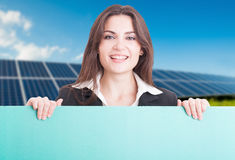 Portrait of friendly business woman holding banner Stock Image