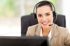 Call center consultant. Portrait of friendly call center consultant with headphones Royalty Free Stock Images