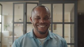 Cheerful african guy winking and smiling playfully