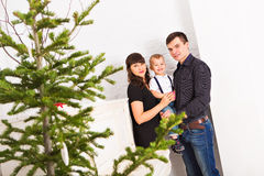 Portrait of friendly family looking at camera on. Christmas evening Stock Image