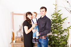 Portrait of friendly family looking at camera on. Christmas evening Royalty Free Stock Images