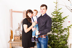 Portrait of friendly family looking at camera on. Christmas evening Stock Photos