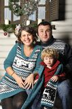 Portrait of a friendly family with pregnant woman during Christmas time Royalty Free Stock Images