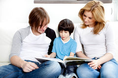 Portrait of friendly family reading book Royalty Free Stock Images