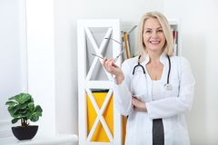 Portrait of friendly female doctor smiling Stock Photos
