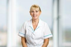 Portrait of friendly female doctor. Stock Photos