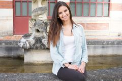 Portrait of friendly girl with a stunning smile and cute looks. Beautiful portrait of friendly girl with a stunning smile and cute looks royalty free stock photography