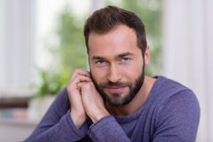 Portrait of a friendly handsome bearded man stock image