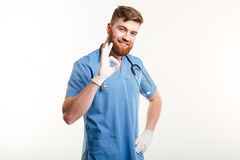 Portrait of a friendly happy male doctor showing ok gesture Stock Images