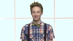 Portrait of friendly looking teenage boy. stock video footage