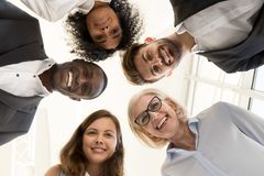 Portrait of friendly multi-ethnic team business people looking a stock images
