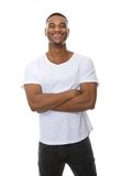 Portrait of a friendly young man smiling with arms crossed Stock Image