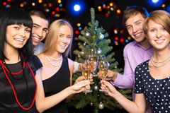Portrait of friends celebrating Christmas Royalty Free Stock Images