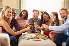 Portrait Of Friends Celebrating With A Toast At Home Royalty Free Stock Photography