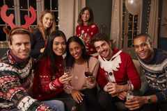 Portrait Of Friends In Festive Jumpers At Christmas Party stock photography
